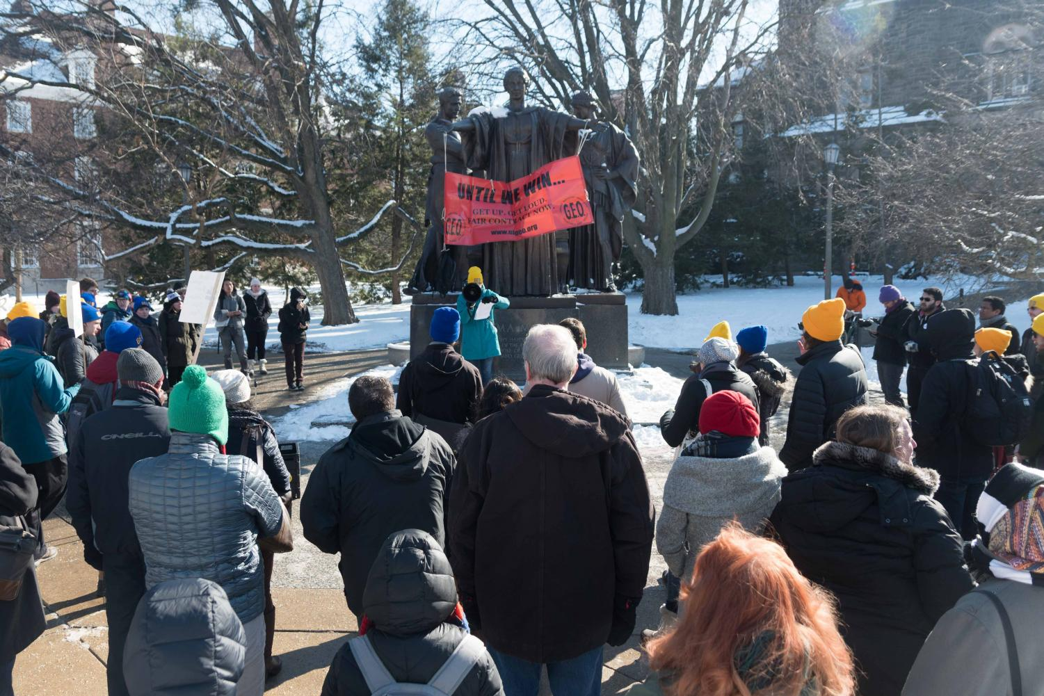 Graduate employees protest at the Alma Mater for a fair contract on Thursday, Jan. 18.