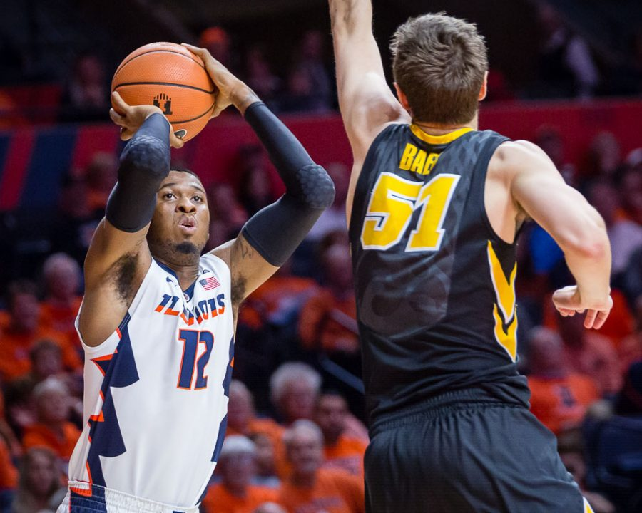 Illinois+forward+Leron+Black+%2812%29+shoots+a+three+during+the+game+against+Iowa+at+State+Farm+Center+on+Thursday%2C+Jan.+11%2C+2018.