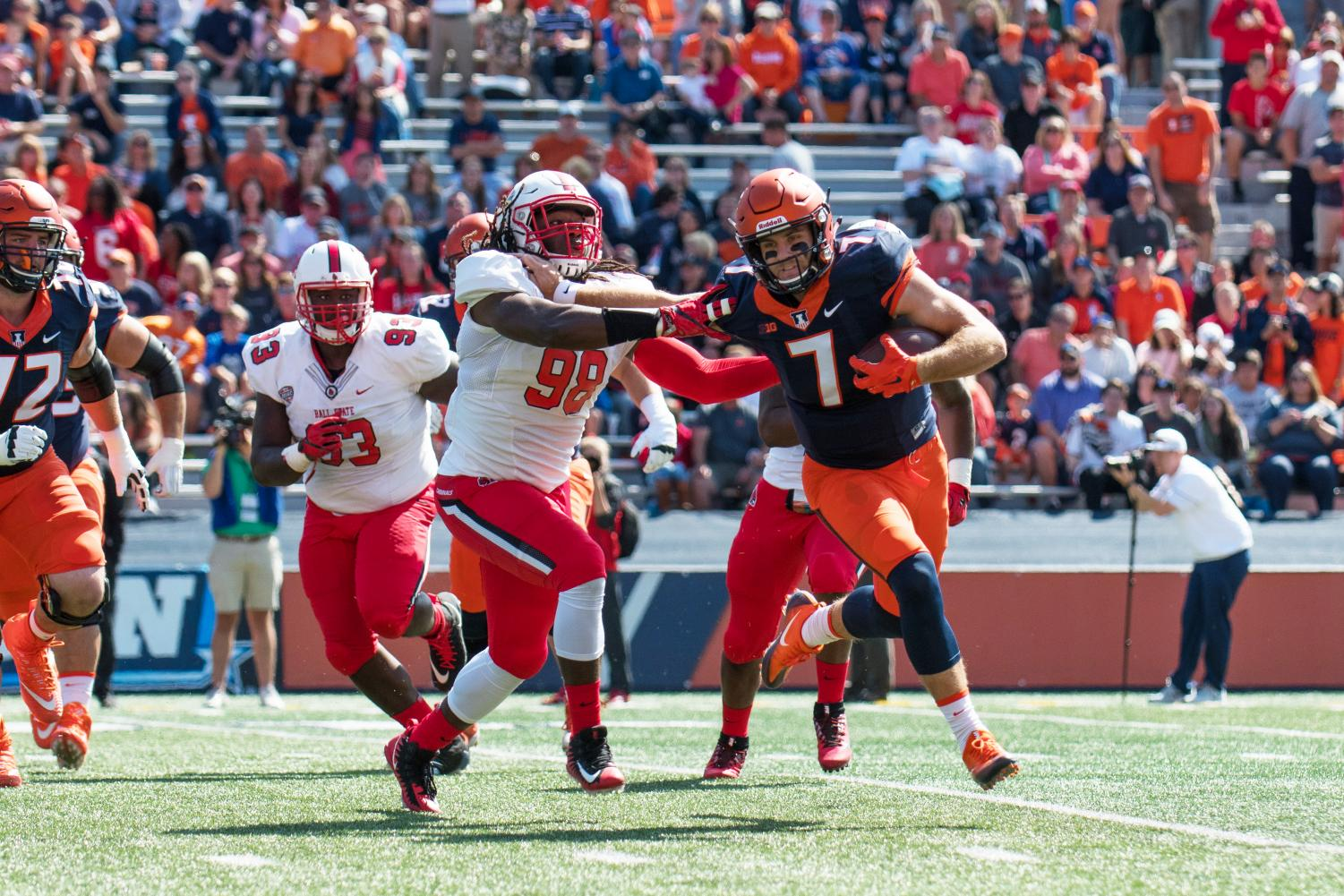 Illinois quarterback Chayce Crouch rolls out of the pocket during the game against Ball State on Saturday, September 2, at Memorial Stadium.