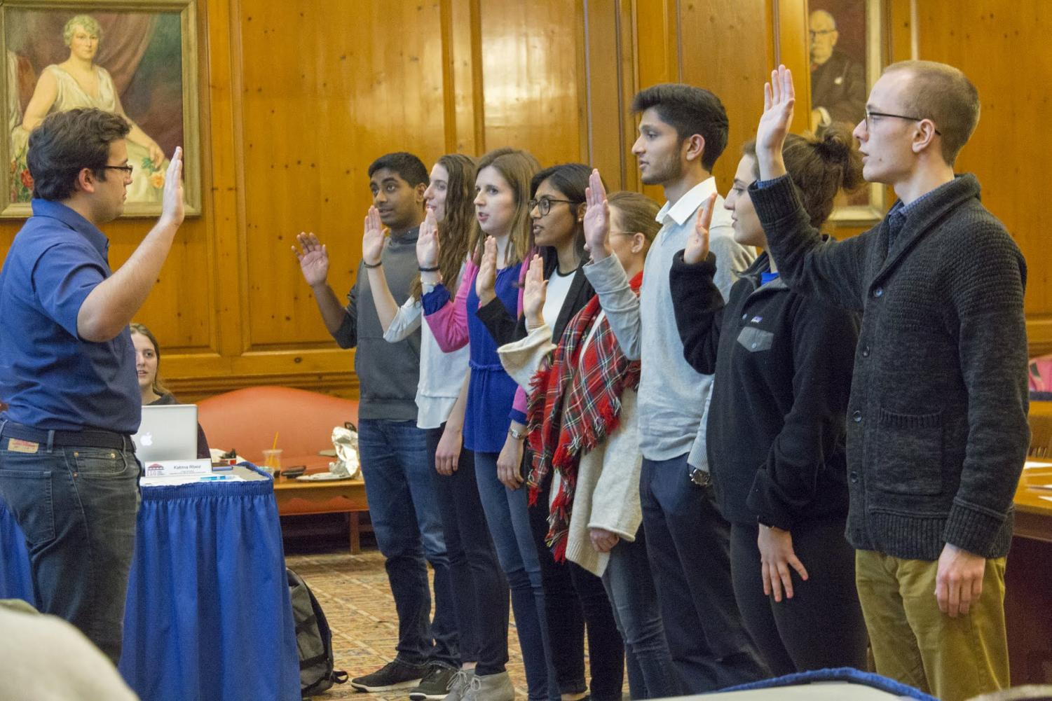 New senate members are sworn in during the Illinois Student Government meeting Wednesday.