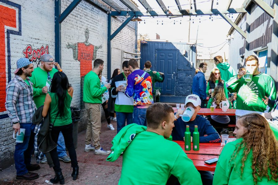 Patrons of Kam's hang out in the beer garden during Unofficial on Friday.