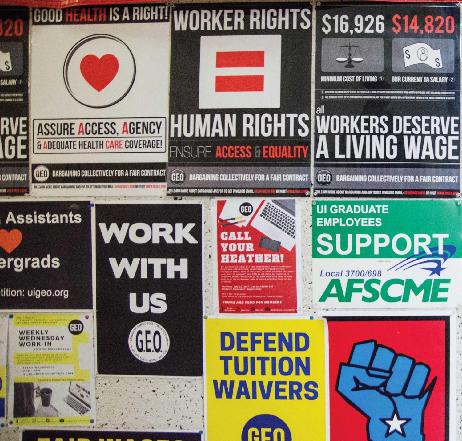 Posters cover the wall outside the Geneva Room at the McKinley Foundation during a GEO meeting on Sunday, February 4.