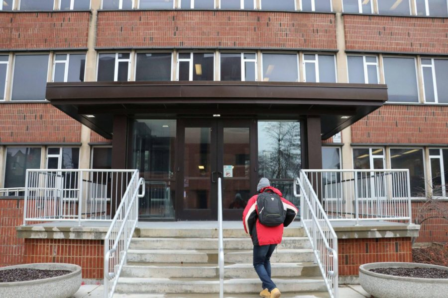 A student walks into the Counseling Center, located at 610 E John St. in Champaign.