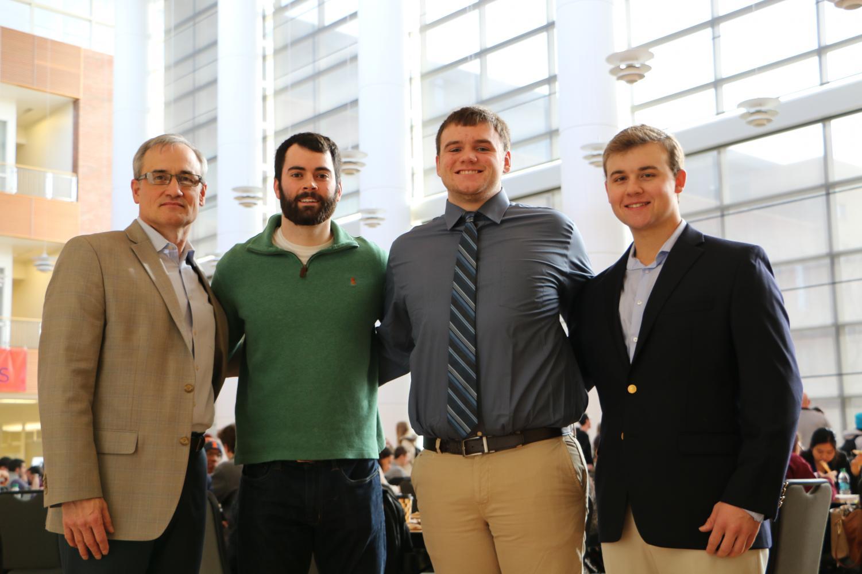 Left to right, Dean Jim Dahl with University Challenge winners Ryan Hanley, Garrett Adamson, and Matthew Schrock on Dec. 14, 2017.