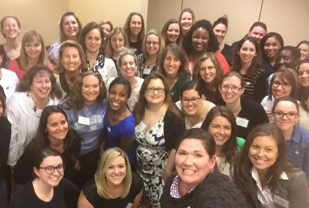 The Junior League of Champaign-Urbana poses for a group photo. The group will host its annual Leadership and Advocacy Conference on Thursday. Roundtable discussions at the conference will encourage women to talk personal health and politics.