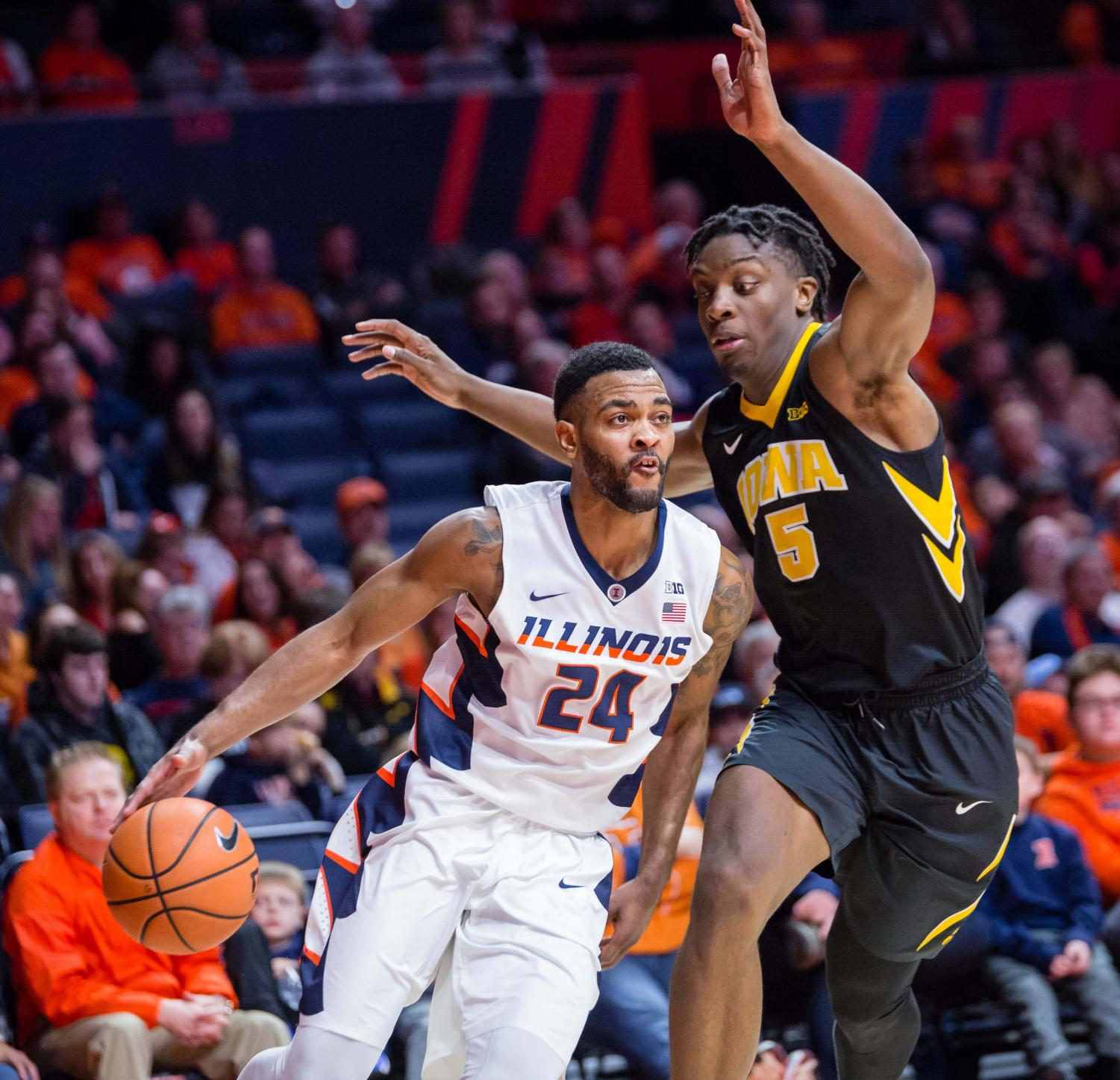 Illinois guard Mark Alstork drives to the basket during the game against Iowa at State Farm Center on Jan. 11. The Illini lost in overtime 104-97.