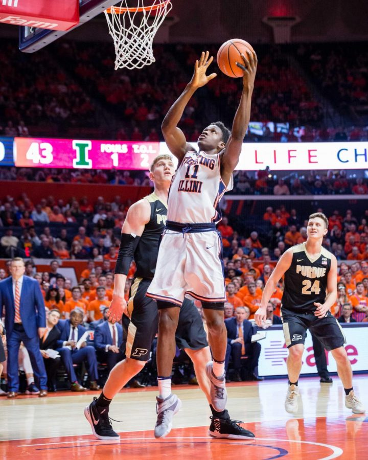 Illinois+forward+Greg+Eboigbodin+%2811%29+puts+up+a+layup+during+the+game+against+Purdue+at+the+State+Farm+Center+on+Thursday%2C+Feb.+22%2C+2018.+The+Illini+lost+93-86.