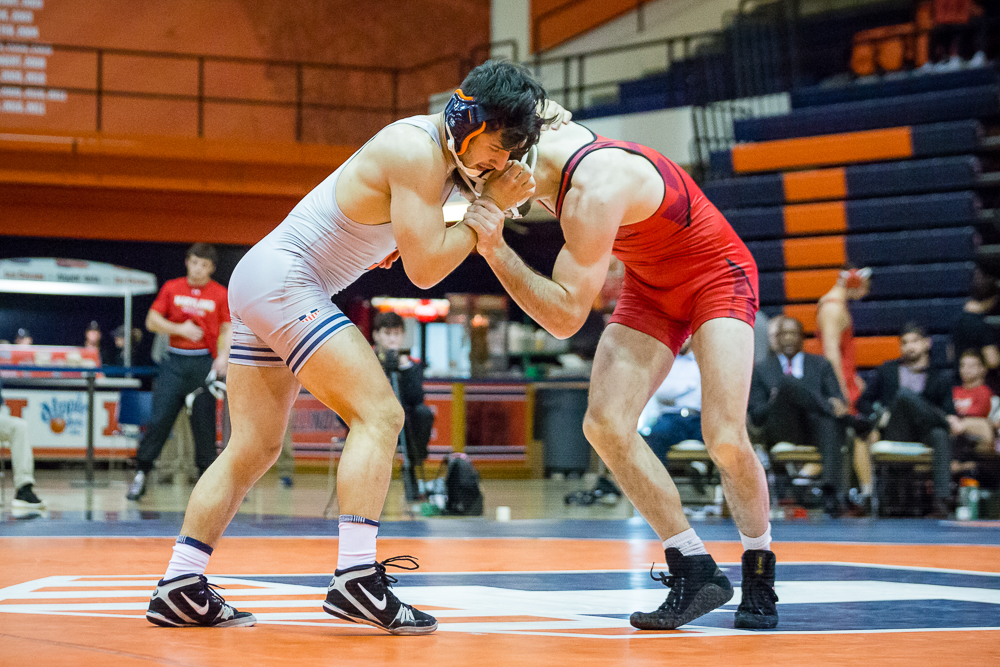 Illinois' Isaiah Martinez wrestles with Maryland's Brendan Burnham in the 165 pound weight class during the meet at Huff Hall on Sunday, Jan. 28, 2018. The Illini won 25-18.