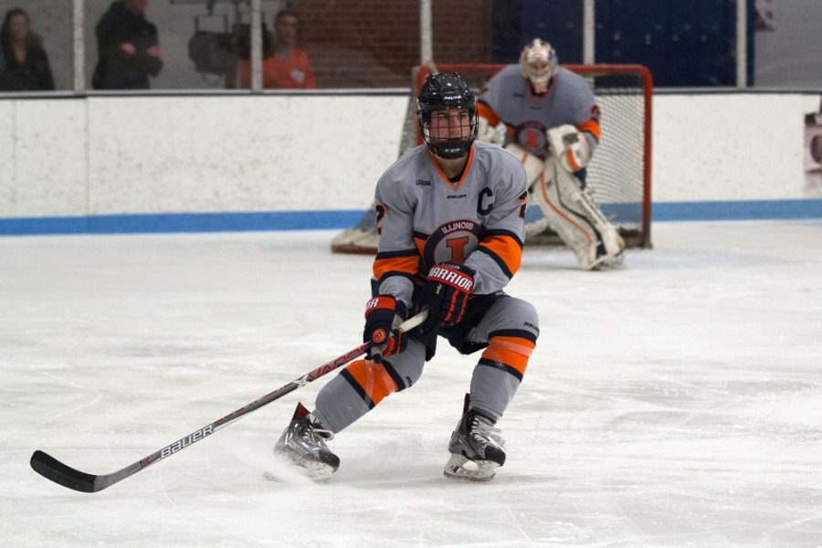 Joey Ritondale (2) skates back into Illini's zone after Robert Morris gains possession of the puck at the Ice Arena on Saturday, Feb. 18. Illini fell to Robert Morris 3-2.