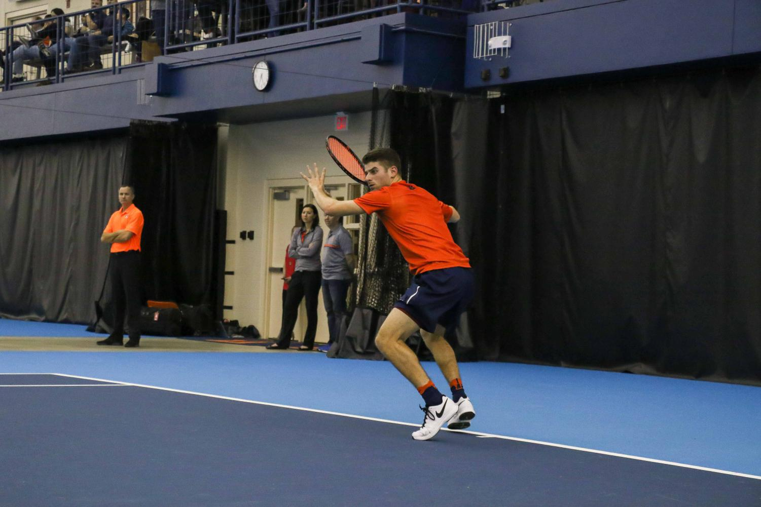 Illinois'  Aron Hiltzik prepares to strike back the ball in the meet against University of Kentucky on Feb. 24, 2017 at the Atkins Tennis Center in Urbana.