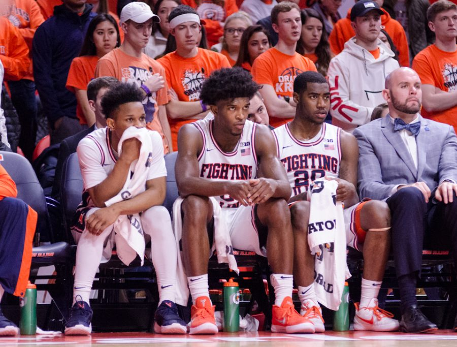 Trent Frazier, Kipper Nichols, and Da'Monte Williams sit in dissapointment towards the end of Illinois' 74-52 loss to Penn State on Sunday, February 11.