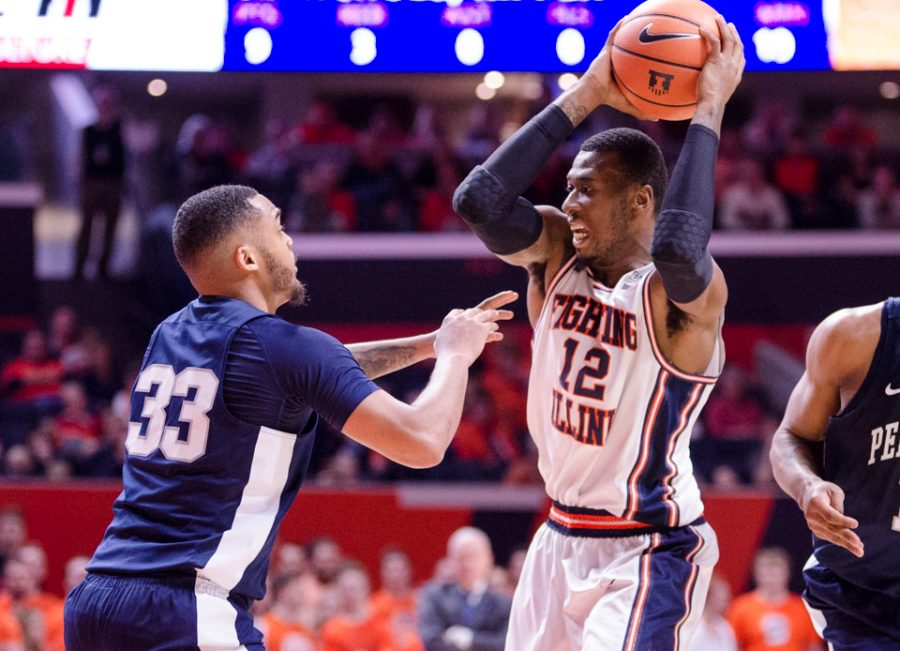 Leron Black looks to pass during Illinois' 74-52 loss to Penn State on Sunday, February 11.