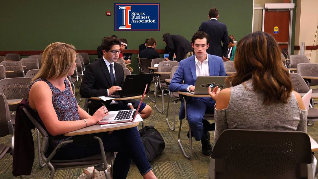 Student work together as a part of Illinois Sports Business. ISB is an RSO which helps students network by connecting their passion for sports with their passion for business.