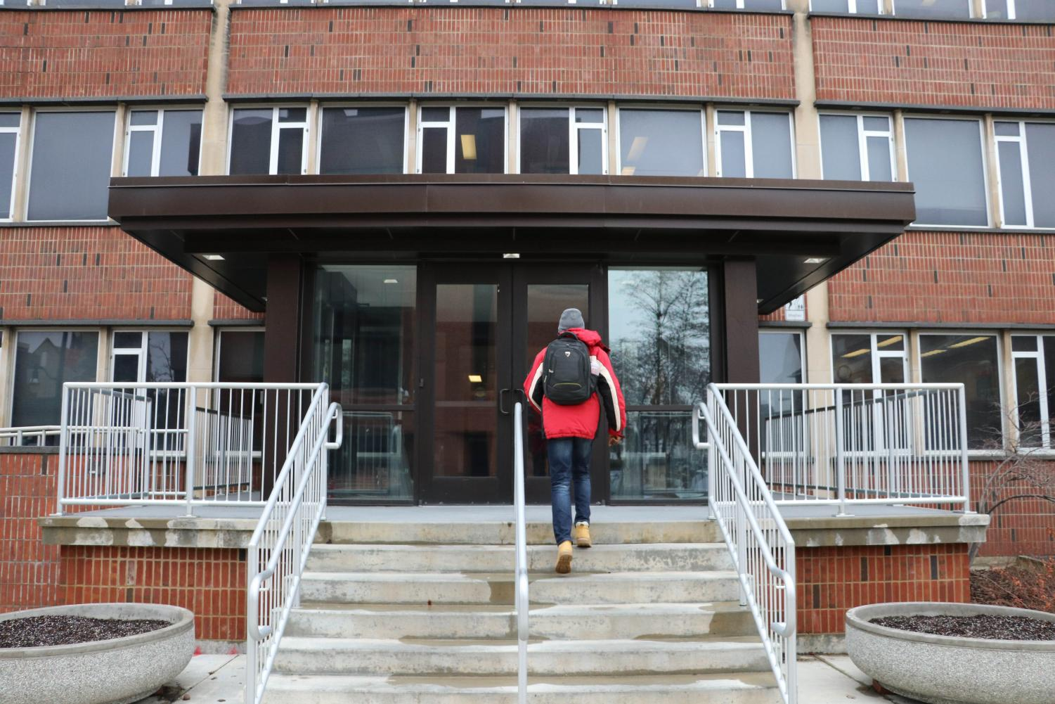 A student walks into the Turner Student Service Building on Feb.21. The Counseling Center is located in the building.