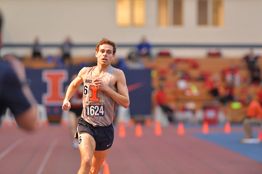 Illinois sophomore Jon Davis runs during the Illini Classic at the Armory in Champaign on Jan. 27. Davis won the 1,600 meter run for the Illini, running a 3:58.46 and he broke the school record in the 3,000 meter run at the Iowa State Classic with a time of 7:49.92 on Friday.