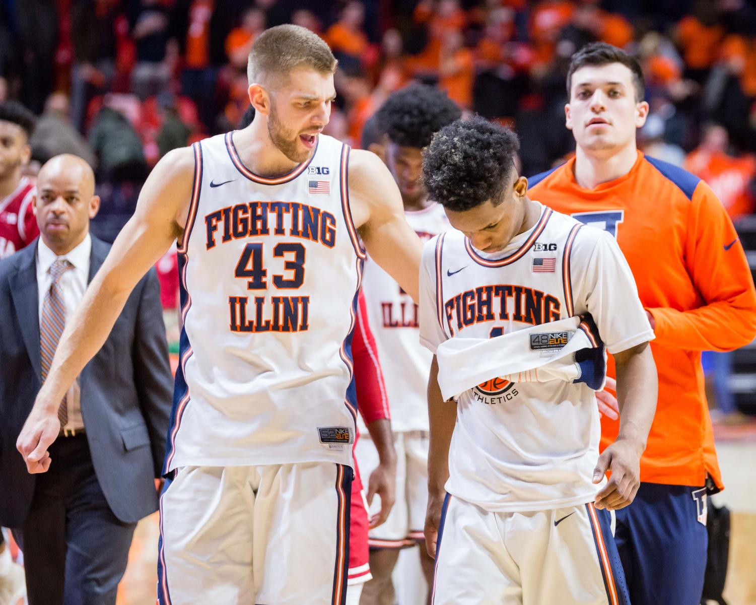 Illinois forward Michael Finke gives Illinois guard Trent Frazier a pat on the back after the game against Indiana at State Farm Center on Wednesday, Jan. 24. The Illini won 73-71.