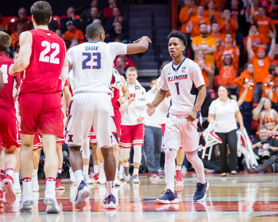 Illinois guard Trent Frazier (1) gets a high five from Illinois guard Aaron Jordan (23) after hitting a three during the game against Wisconsin at the State Farm Center on Thursday, Feb. 8, 2018.