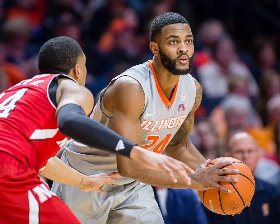 Illinois+guard+Mark+Alstork+%2824%29+looks+to+pass+the+ball+during+the+game+against+Nebraska+at+the+State+Farm+Center+on+Sunday%2C+Feb.+18%2C+2018.