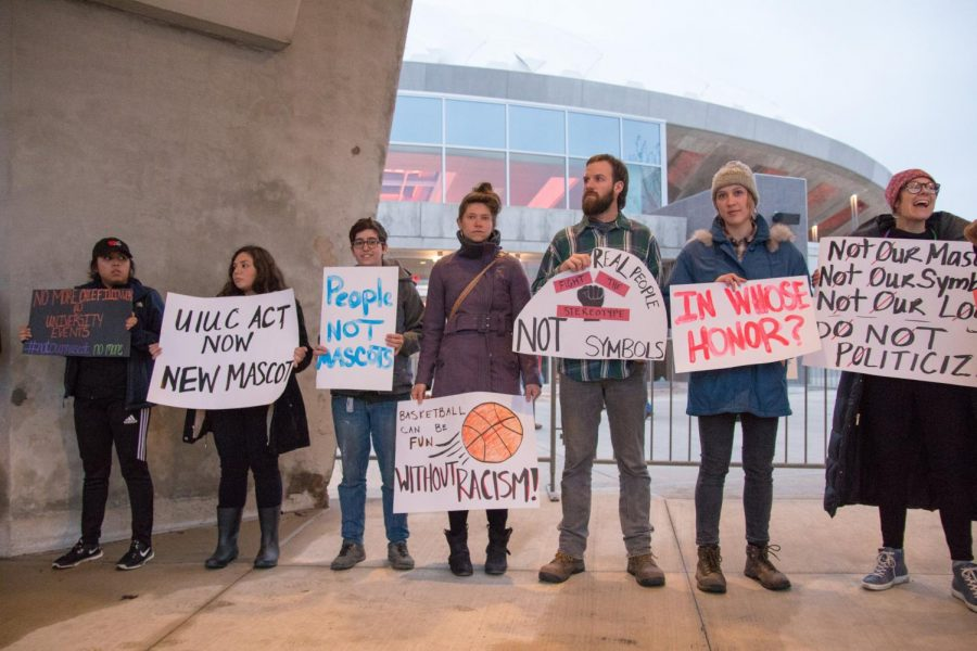 Protesters of Chief Illiniwek gather outside the west entrance of State Farm Center before the basketball game against Purdue on Feb. 22.