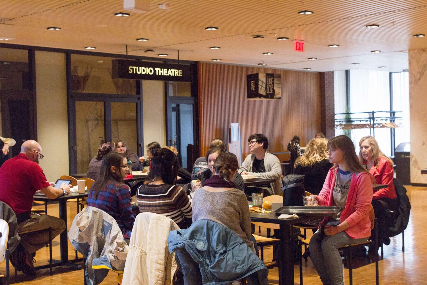 Students sitting outside of the Studio Theater in the Krannert Center located at 500 S Goodwin Ave in Urbana.