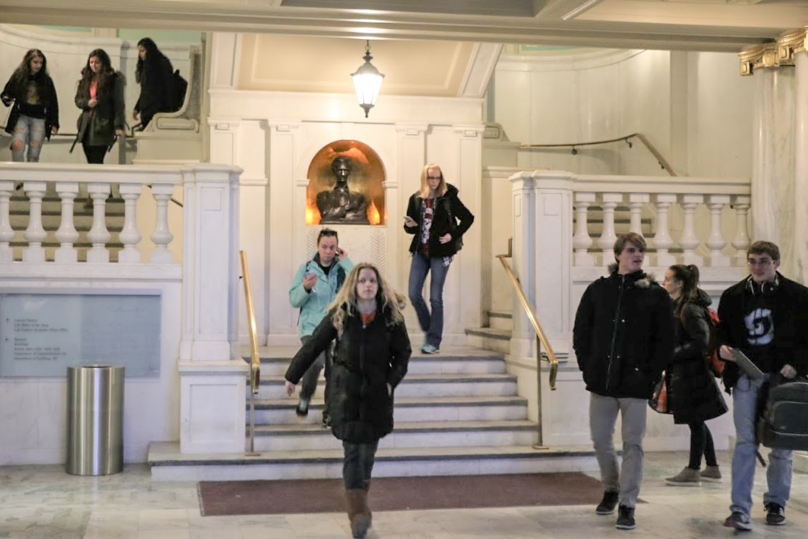 Students walk down the stairs in Lincoln Hall on Tuesday.