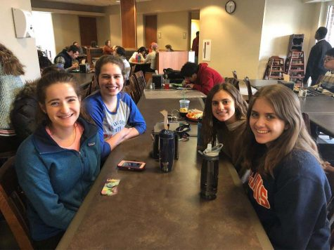 UI students pose for a photo in Newman Hall's dining hall.