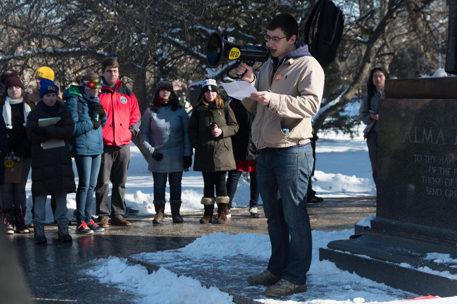 Graduate employees protest at the Alma Mater for a fair contract on Jan 18. The Graduate Employees' Organization announced this morning that it will begin striking Feb. 26 if an agreement with University administration is not reached beforehand.