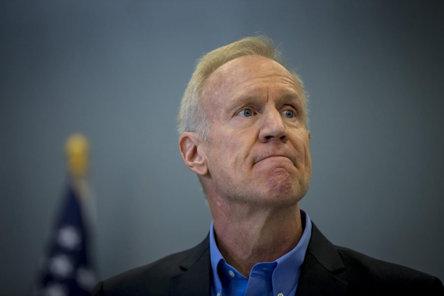 Illinois Gov. Bruce Rauner attends a bill signing on Thursday, Aug. 24, 2017 at the Safer Foundation North Lawndale Adult Transition Center.