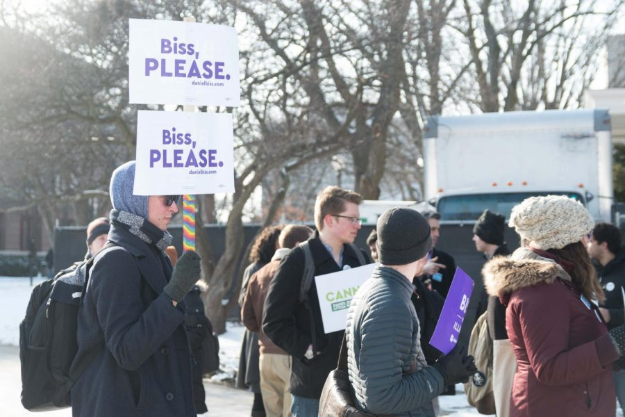 A student holds a Daniel Biss sign on the Main Quad on Thursday.