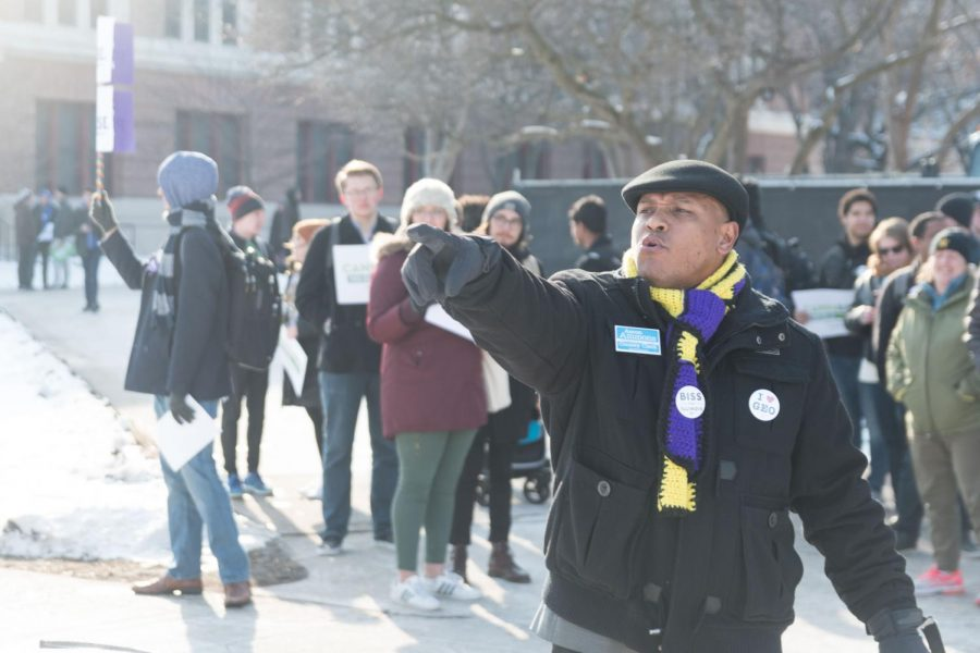 Candidate for Champaign county clerk Aaron Ammons engages students on the Main Quad on Thursday. Carol Ammons, state representative, was also present at the rally.