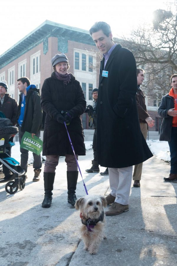 Illinois Democratic gubernatorial candidate Daniel Biss meets a dog while at the Daniel Biss Rally on the Main Quad on Thursday. At the rally, Biss spoke about free higher education and the legalization of cannabis.