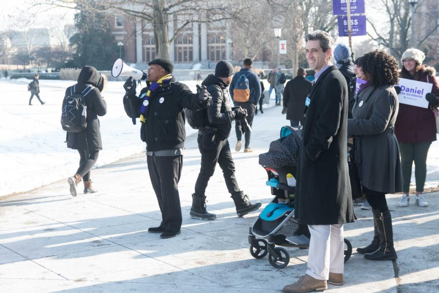 Illinois Democratic gubernatorial candidate Daniel Biss greets passing students on the Main Quad on Thursday. During the rally, Biss spoke about the lack of early voting resources on campus.