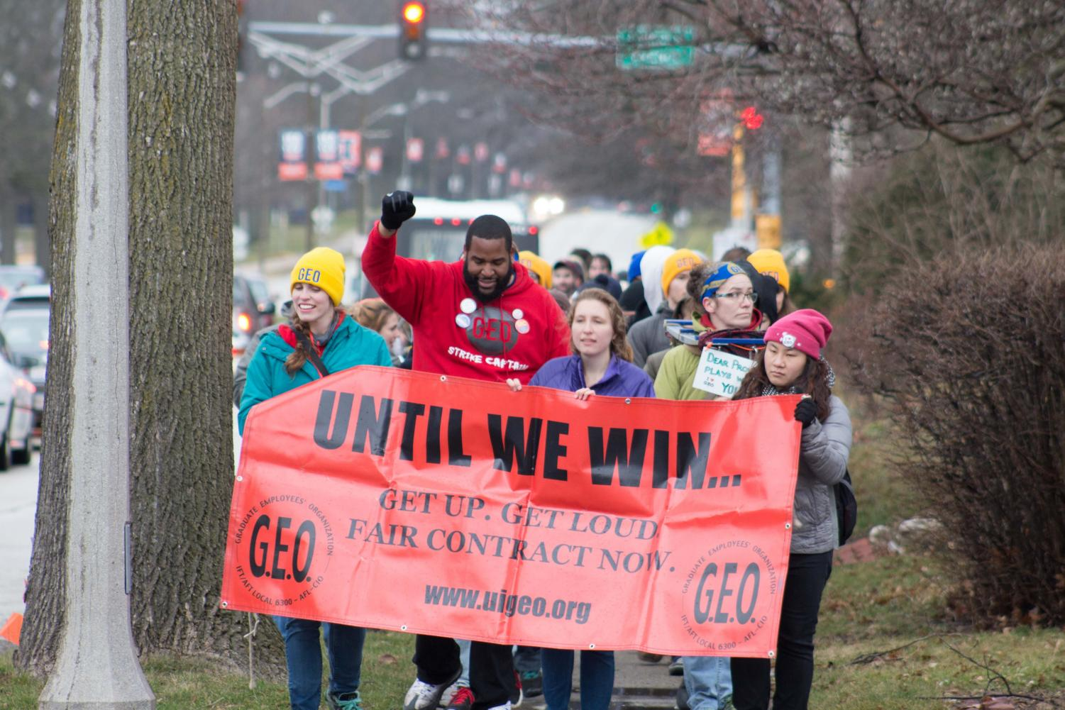Members of the Graduate Employees' Organization march toward University President Timothy Killeen's house along Florida Avenue on March 6. An agreement has been made between the GEO and University administration that grants many of the GEO's demands for a new contract.