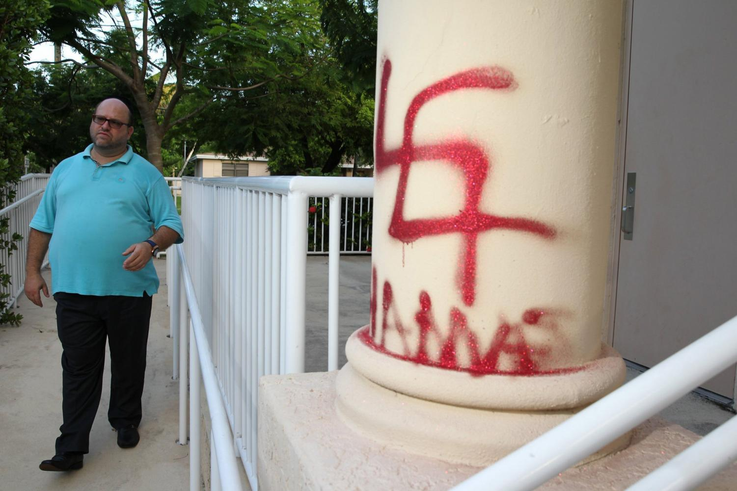 Yona Lunger, who is a part of his neighborhood watch group, was patrolling an area in Northeast Miami-Dade early Monday, July 28, 2014 when he found anti-semitic painting on the Tora V'Emunah temple at 1:30am in Miami, Fla.