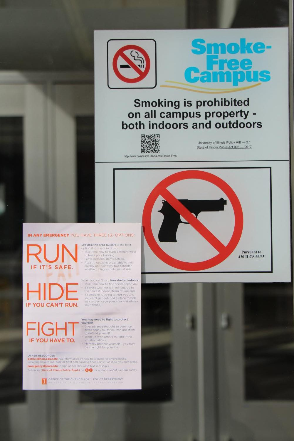 """Flyers depicting the """"run, hide, fight"""" phrase were posted to residence halls and distributed to students."""
