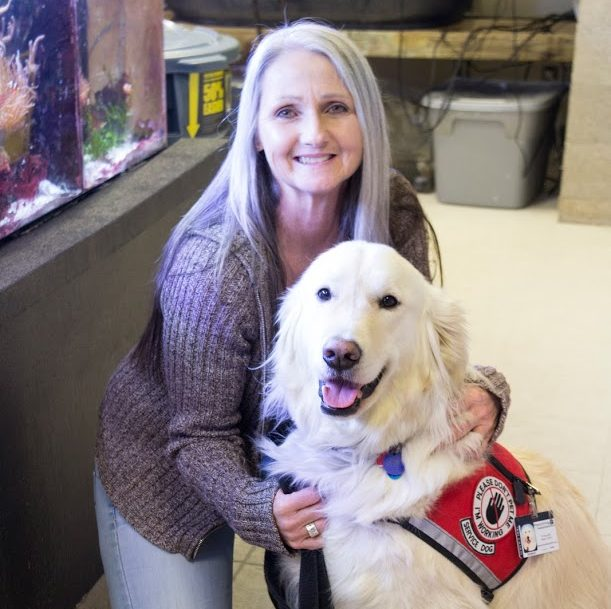 Sampson with his owner at Beckman Institute Marine Lab. Sampson, a trained service dog who works with Joey Ramp, was nominated for the American Humane Hero Dog Award and brings awareness to the impact service dogs have.