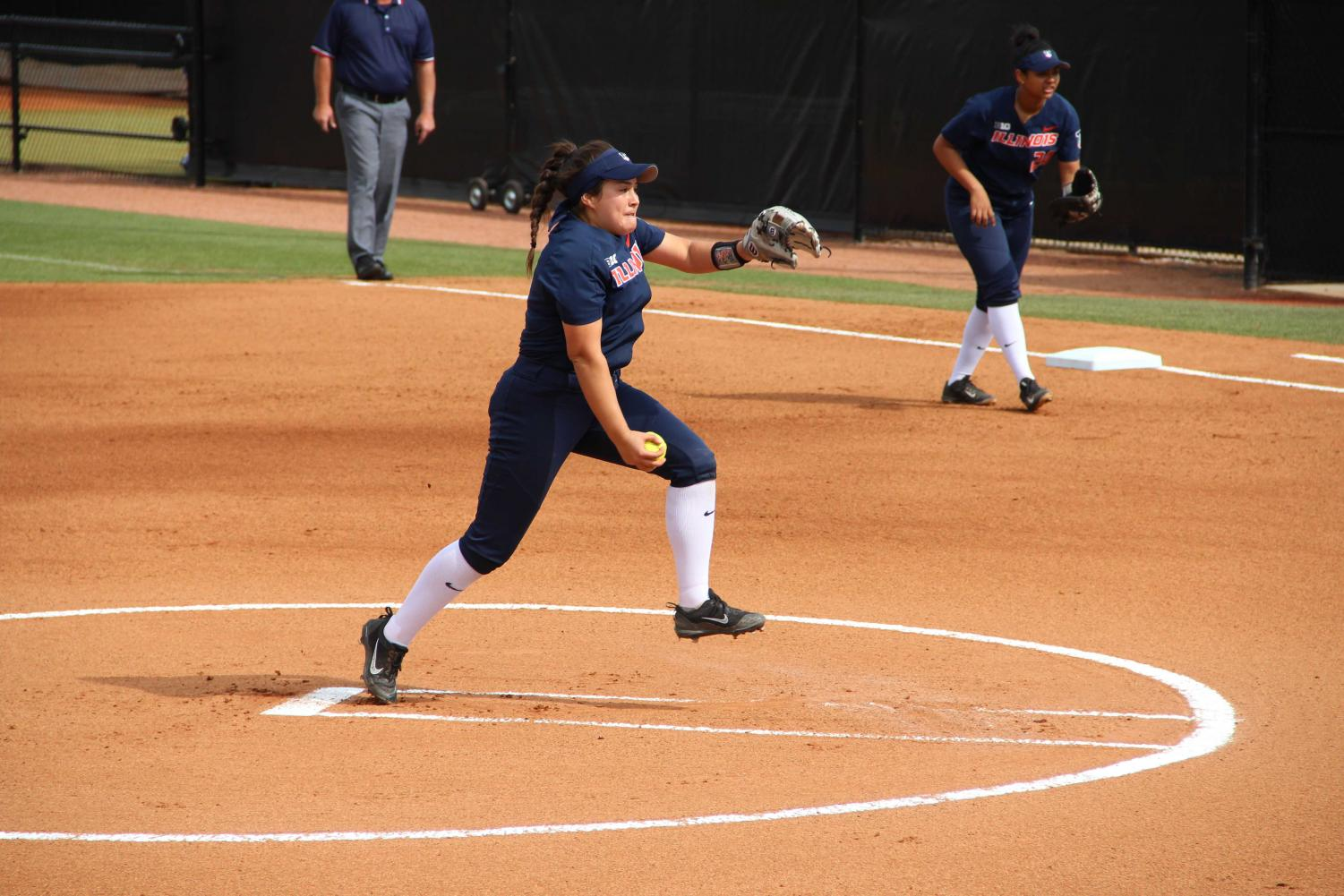 Junior Emily Oestreich pitches for Illinois. Oestreich recently moved from California and is adjusting to being on such a large campus, but she finds comfort in her new teammates.