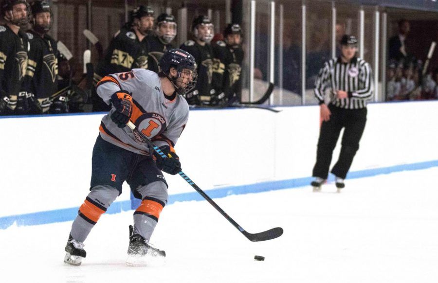 Eric Cruickshank (15) passes to a lineman across the ice past Lindenwood's players at the Ice Arena on Friday, Dec. 1.  Illini won in overtime 2-1.