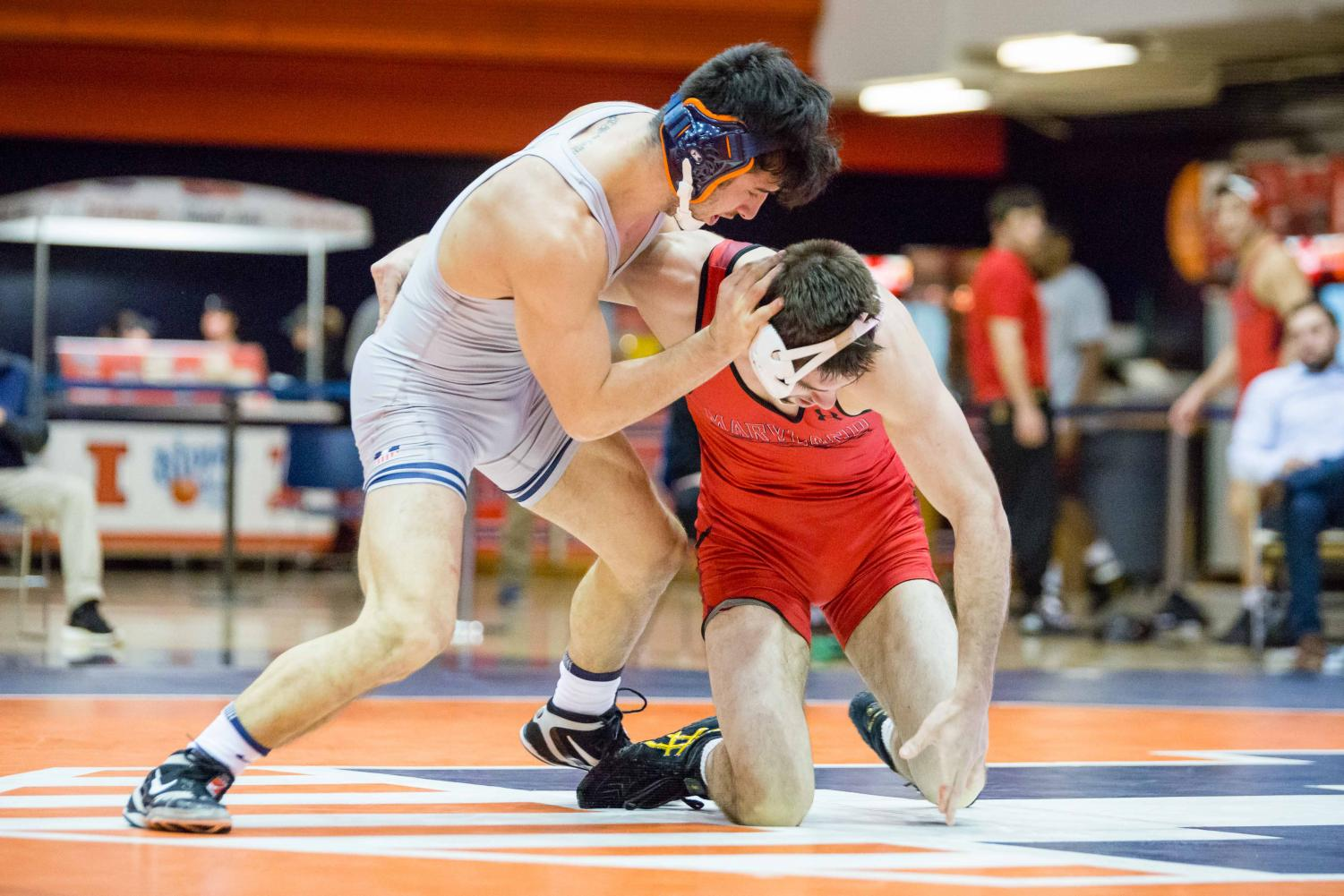 Illinois' Isaiah Martinez wrestles with Maryland's Brendan Burnham in the 165-pound weight class during the meet at Huff Hall on Jan. 28. The Illini won 25-18.