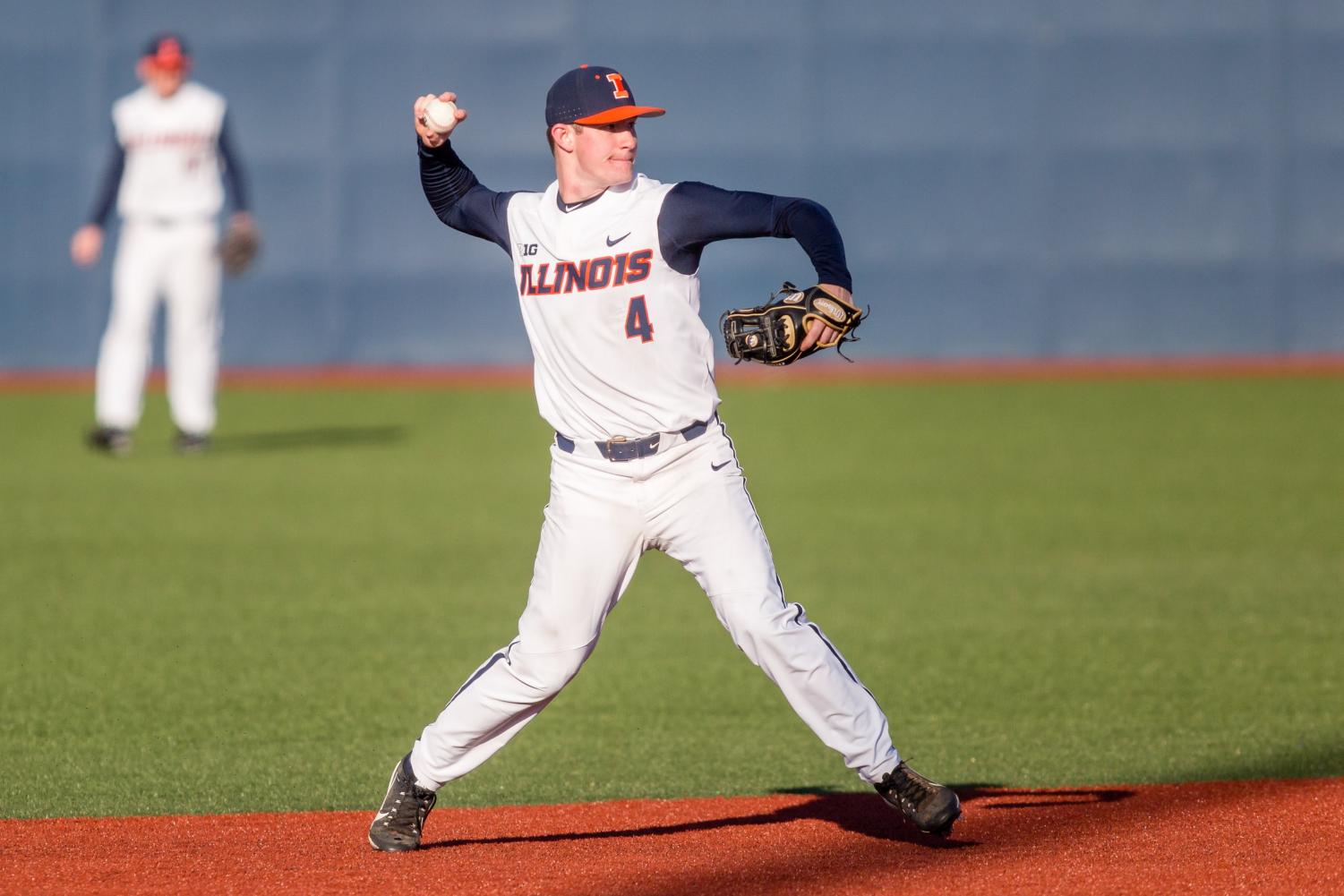 Illinois shortstop Ben Troike makes a throw to first during the game against Milwaukee at the Illinois Field on March 14. When playing Northwestern this weekend, Troike made a play that gained him the No. 5 slot on SportsCenter's Top 10.