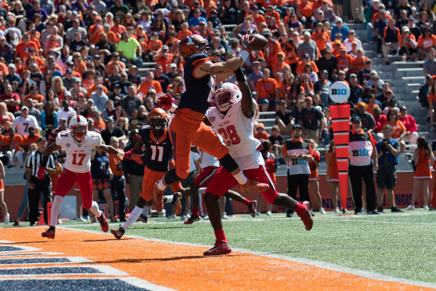 Illinois wide receiver Mike Dudek catches a touchdown pass during the game against Ball State on Sept. 2 at Memorial Stadium. Dudek is getting ready for his senior season.