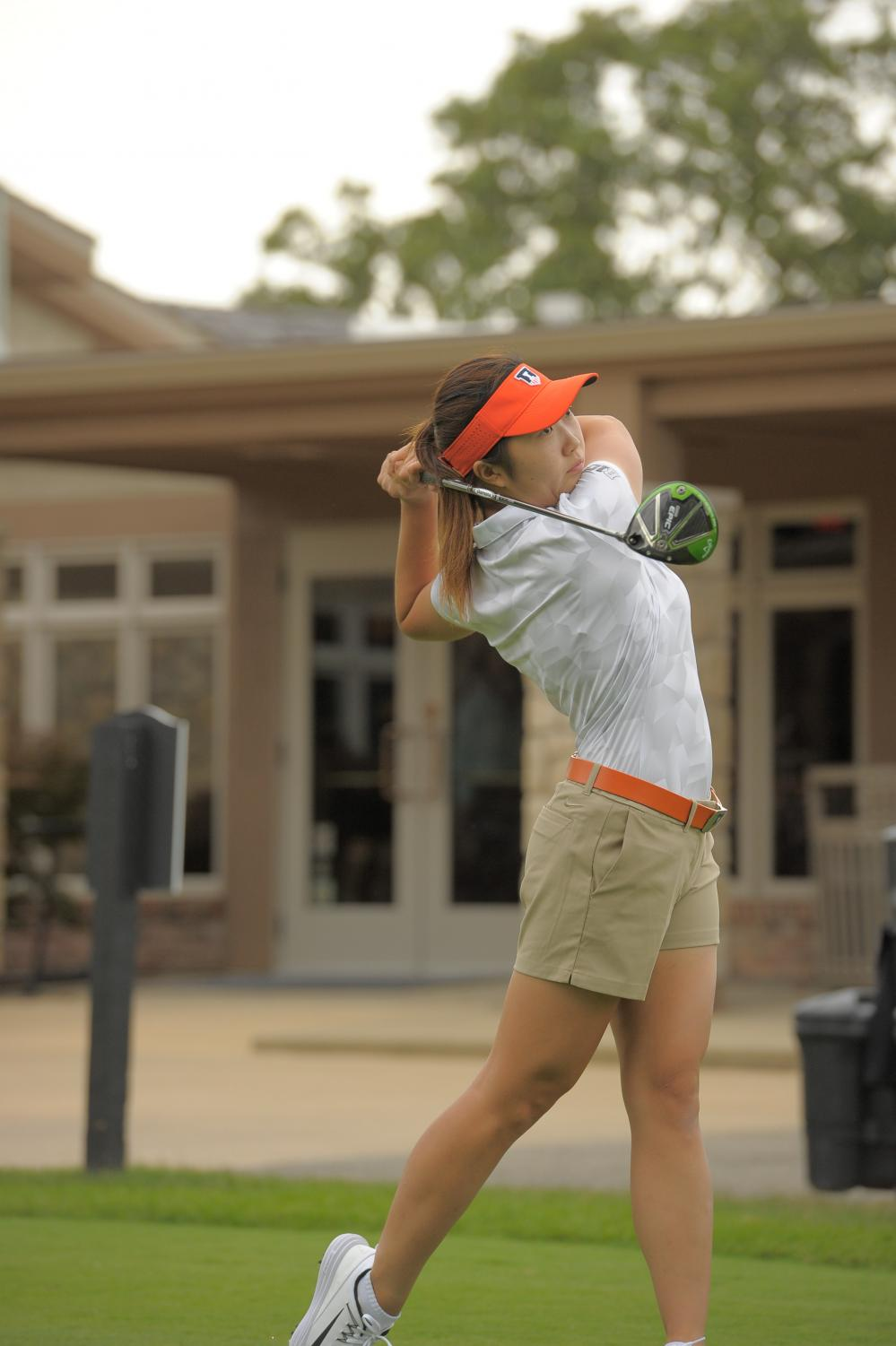 Illinois senior Grace Park takes a swing for the women's golf team. Illinois participated in a tournament at Briar's Creek where it placed ahead of Penn State. Park was a major factor in the team's performance.