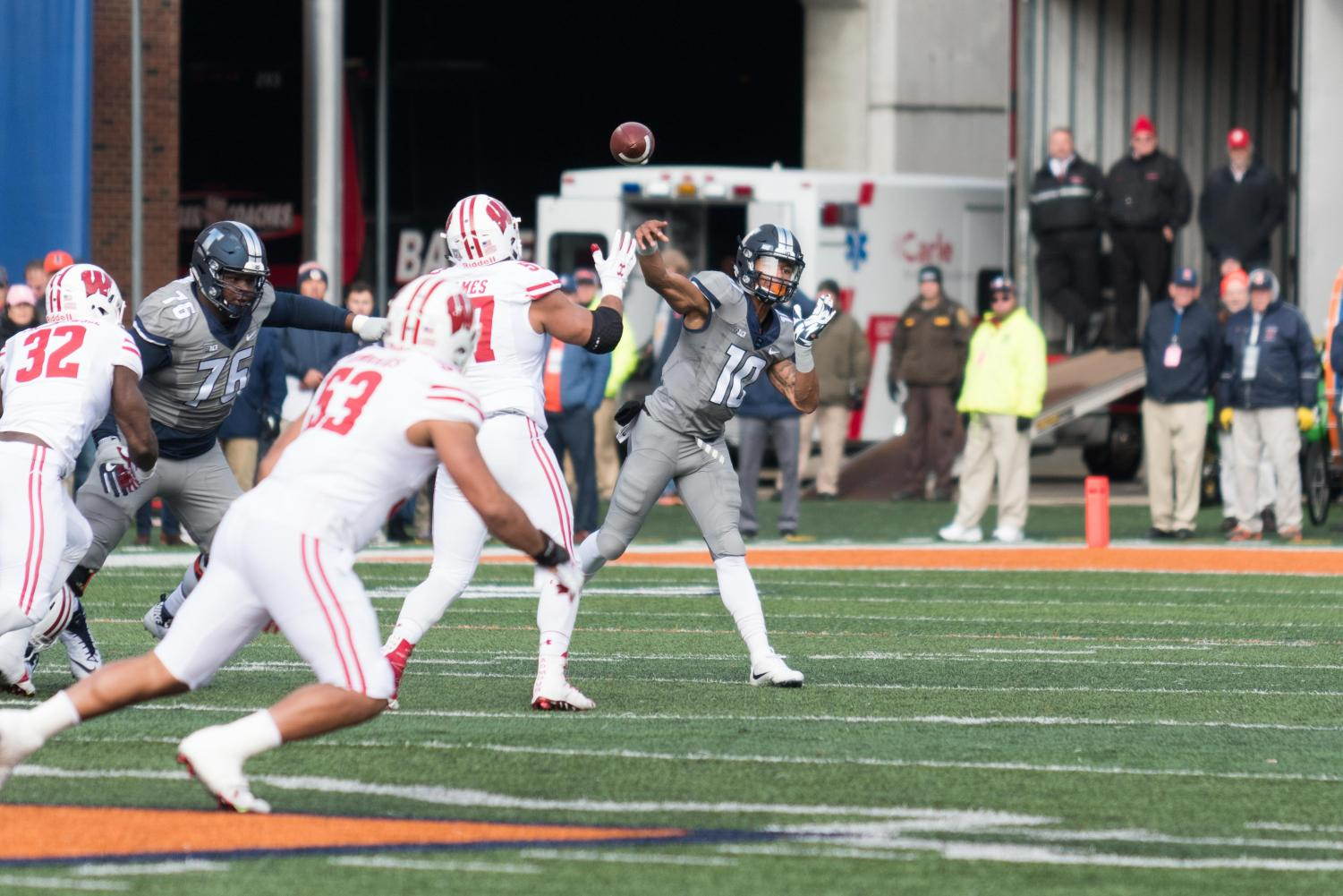 Illinois quarterback Cam Thomas throws a pass under pressure during the game against Wisconsin on Saturday, Oct 28. The Illini lost 10-24.