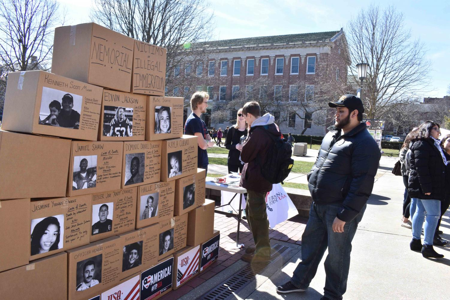A student examines the Wall for Victims demonstration by Turning Point USA on the Main Quad on Mar. 15.