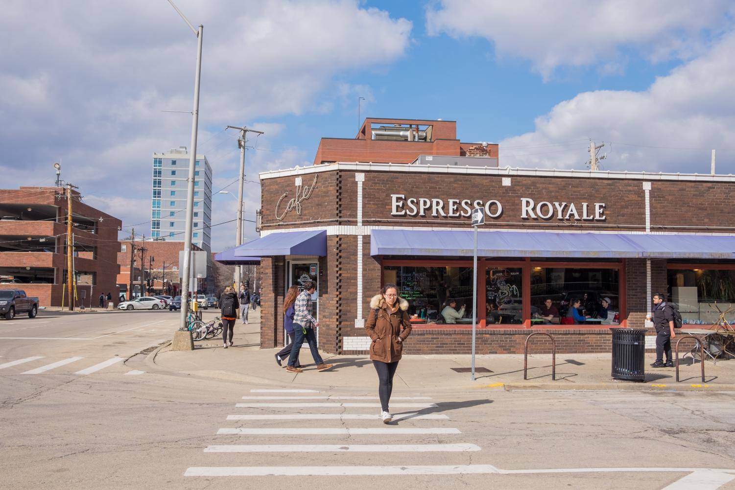 Students walking in front of Espresso Royale, located at 1117 W. Oregon St. in Urbana.