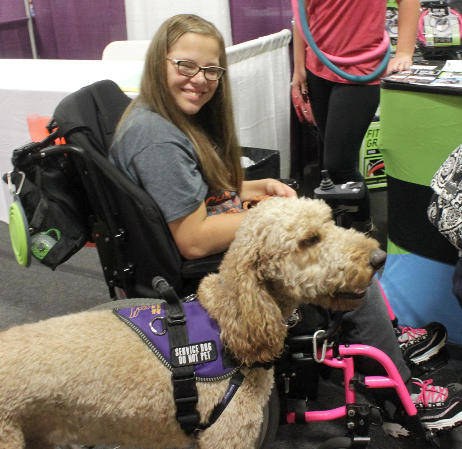A person in a wheelchair poses for a photo during the disABILITY Resource Expo in 2017.