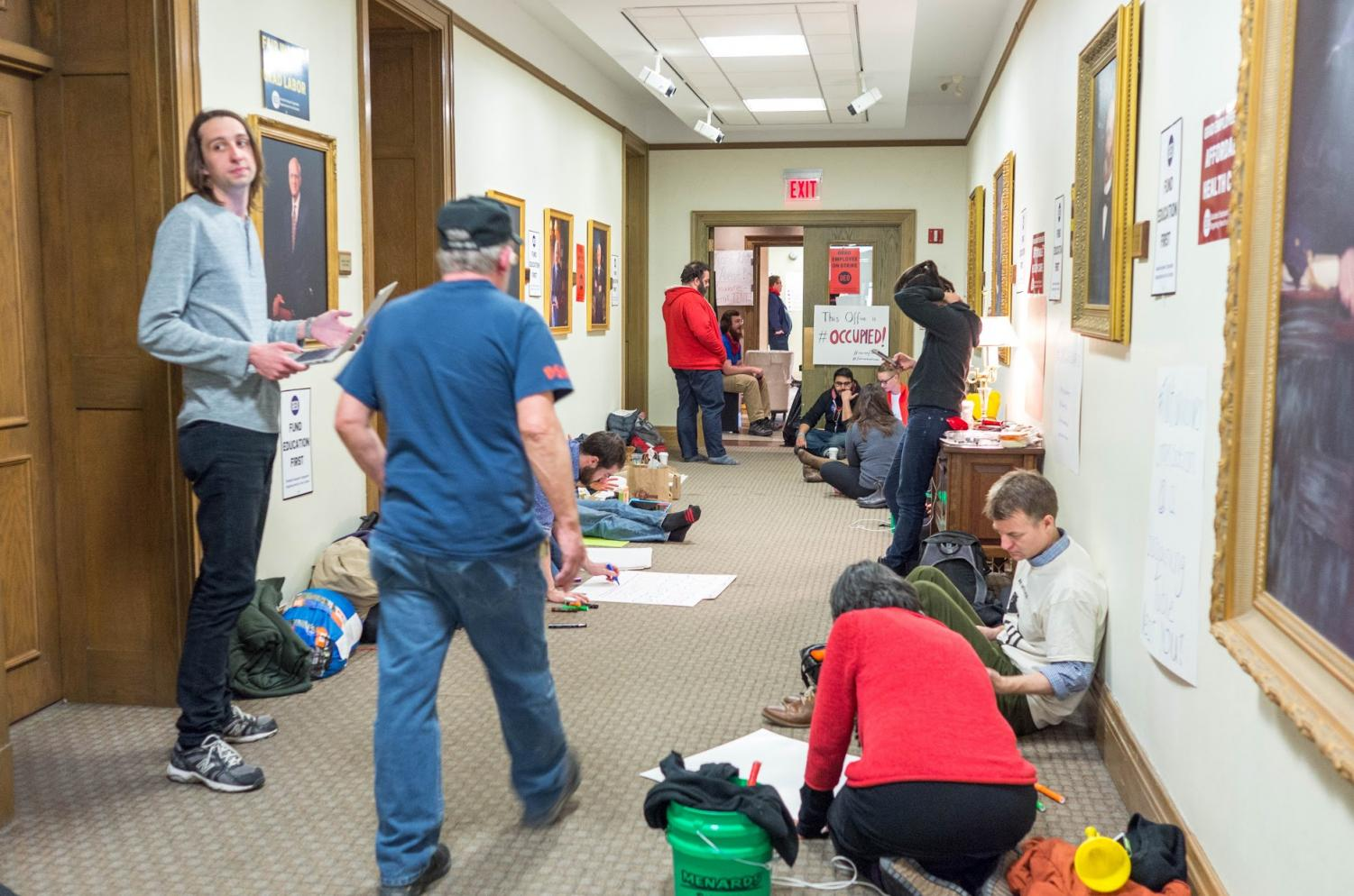 GEO occupied the hallway outside University President Timothy Killeen's office in Henry Administration Building on Wednesday.