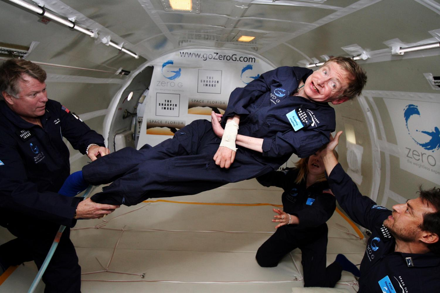 Physicist Stephen Hawking enjoys zero gravity during a flight aboard a modified Boeing 727 aircraft.