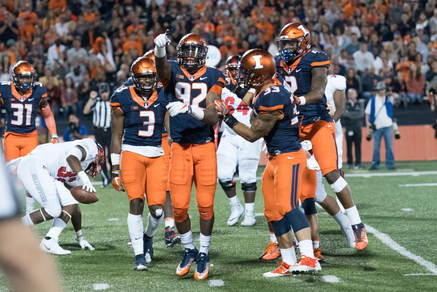 Illinois players celebrate a defensive stop in their game against Western Kentucky on September 9, 2017. Illinois picked up its second and last victory of the season in a 20-7 win.