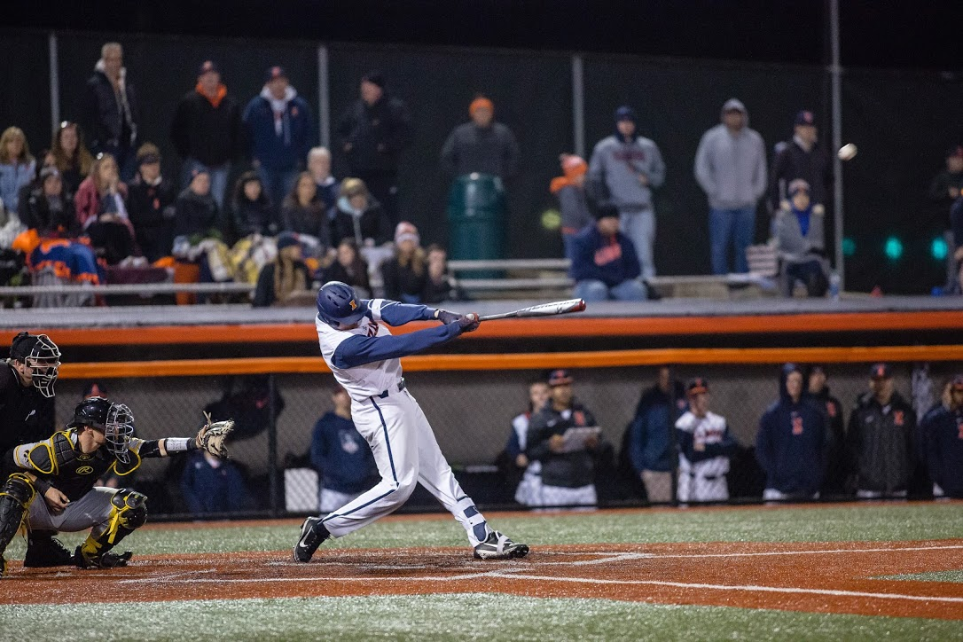 Illinois infielder Bren Spillane hits a home run during the game against Iowa at Illinois Field on Friday. The Illini lost 8-5